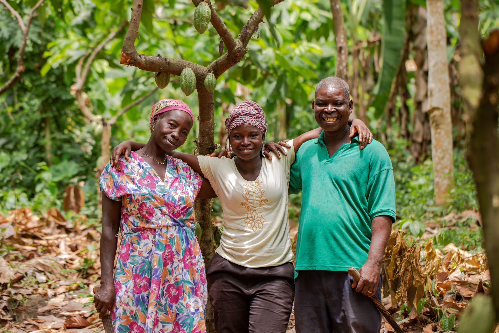 Mawuse Hotor (middle) and her parents, Mary Ahotor and Gabriel, cocoa farmers in Ghana