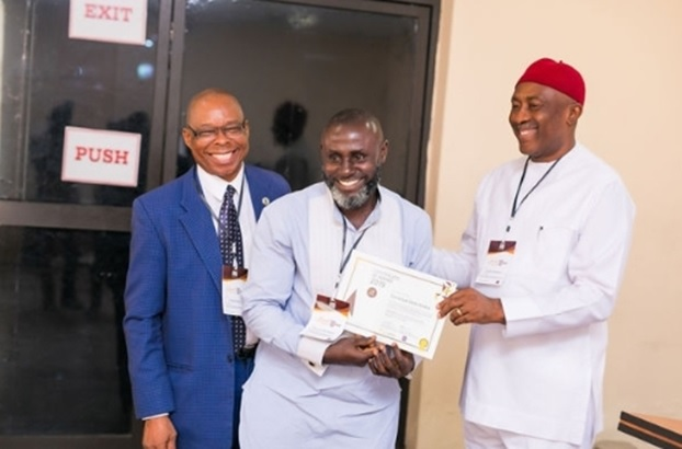 L-R: Professor Fakae (Trust Board Member), Emmanuel Sorle Yowika (scholarship beneficiary), and Hon. Uche Onyeagucha (Chairman of the Board, Kiisi Trust)